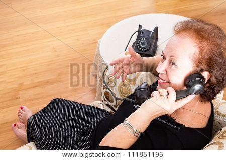 Grandma Chatting On An Old Rotary Telephone