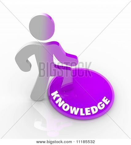Person Stepping Onto Knowledge Button