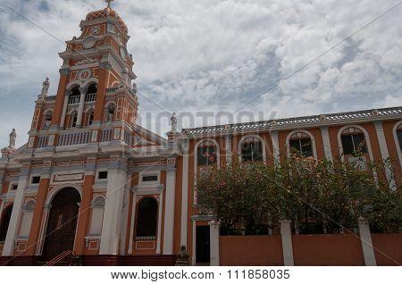 Front of rose latino cathedral Xalteva church under blue sky in Granada