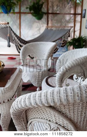 Rattan furniture chair and table with hammock in a room