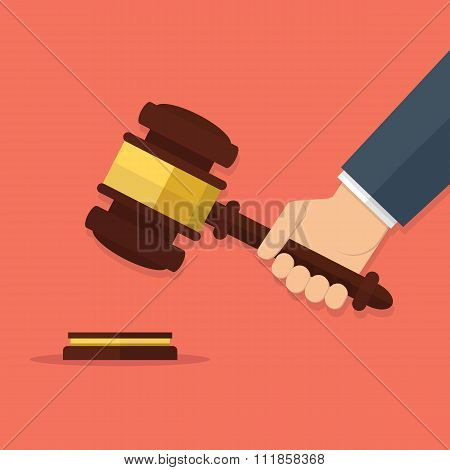 Hand holding judges gavel