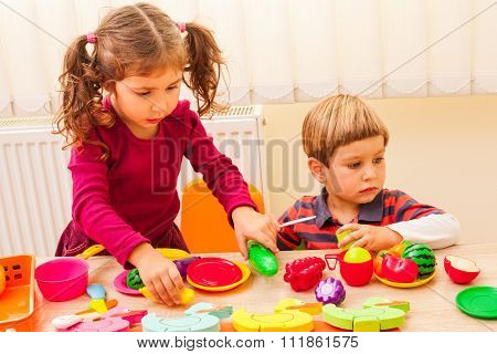 Children playing cooks