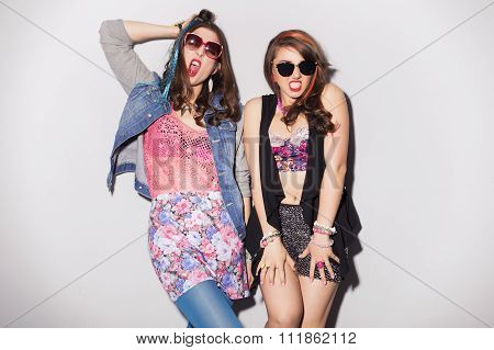 Two Beautiful Brunette Women (girls) Teenagers Spend Time Together Having Fun, Make Funny Faces. Ret