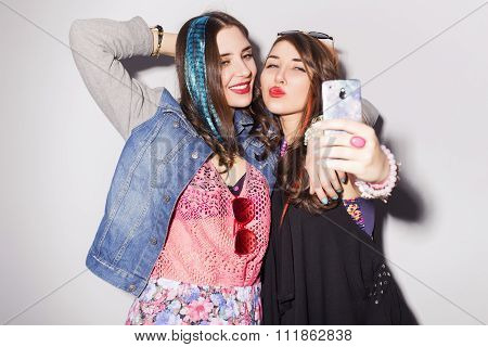 Two Beautiful Brunette Women (girls) Teenagers Spend Time Together Having Fun, Make Funny Faces, Mak
