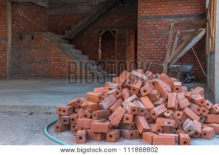 Group Of Red Bricks Inside Building With Construction Unfinished