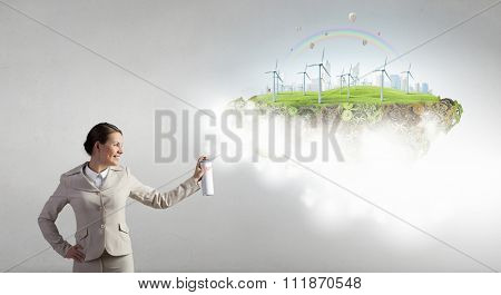 Young businesswoman spraying eco concept from aerosol balloon