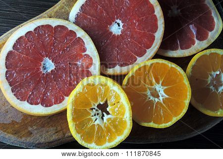 Grapefruit And Mandarin On A Wooden Board