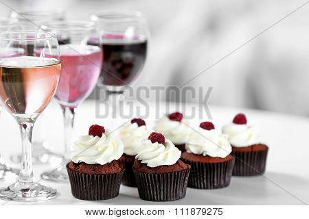 Tasting of wine and chocolate cupcakes, close up