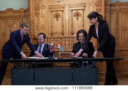 ST. PETERSBURG, RUSSIA - DECEMBER 15, 2015: Russian Minister of culture Vladimir Medinsky and Minister of culture of Abkhazia Elvira Arsalia signs the plan of cooperation during Cultural Forum