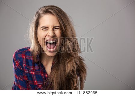 Young Woman Screaming Loudly.