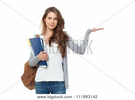 Portrait Of Happy Student Showing Something Isolated On White Background.
