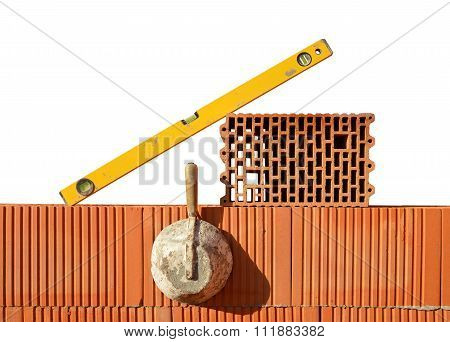 Masonry tools on red brick wall