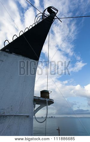 Vertical Superstructure Of A Marine Vessel On A Background Of Blue Sky.