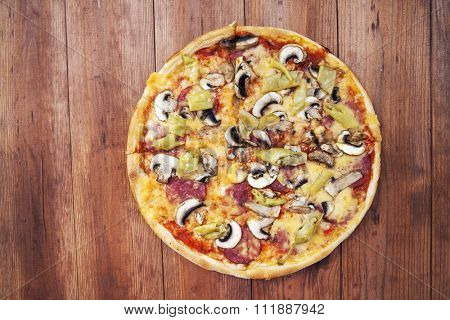 pizza isolated on a wooden background