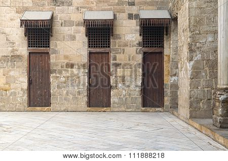 Three Doors In A Stone Wall At The Main Courtyard In A Historic Mosque