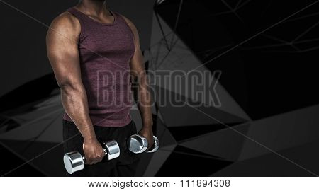 Fit man exercising with dumbbell against abstract angular design