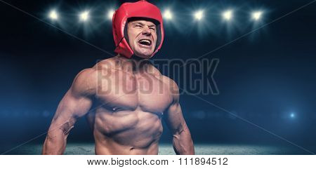 Angry boxer with headgear against desert landscape