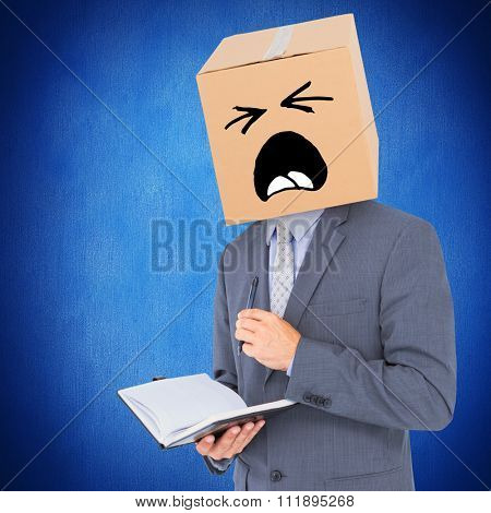 Anonymous businessman with diary against blue background