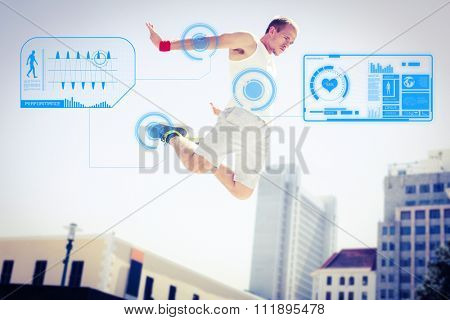 Man doing parkour in the city against fitness interface