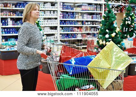 Beautiful Woman With Shopping Cart In Supermarket At Christmas Sale