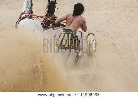 Determination, Roman chariots in the circus arena, fighting warriors and horses