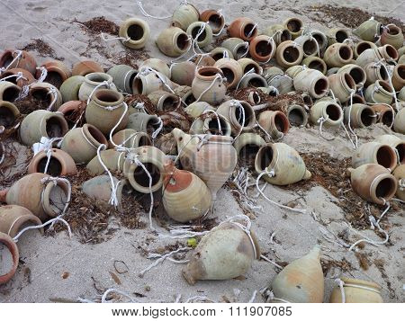 Many Old Amphoras In The Sand