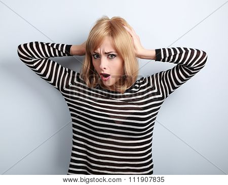Confused Young Woman With Surprising Big Eyes Holding Hand Hair. Stress Concept