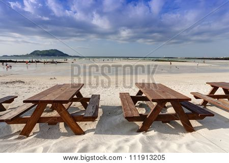 Empty wooden table on the beach, Jeju Island, South Korea
