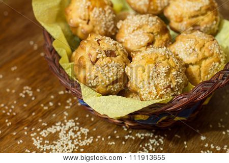 Salty muffins with sausage, cheese and sesame in basket
