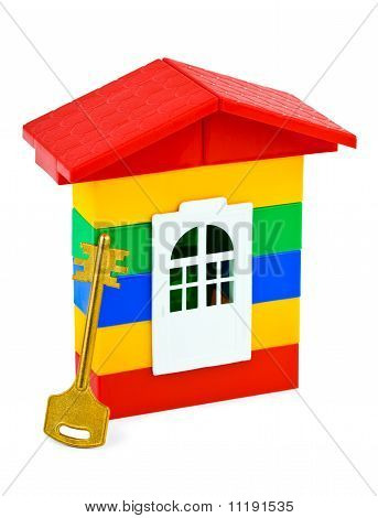 Clave y casa de juguete