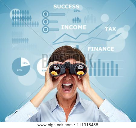 Business woman with binoculars over chart background.