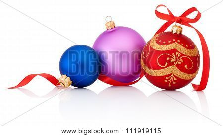 Three Colored Christmas Baubles With Ribbon Bow Isolated On White Background
