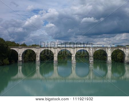 Reflection Of An Arched Bridge With Train