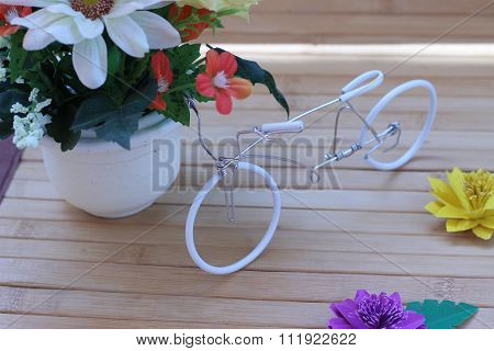 Beautiful Flowers In A Vase On A Wooden Brown Background