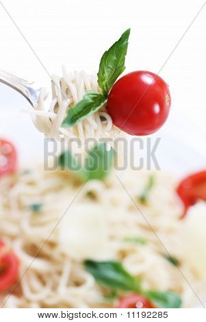 Spaghetti, Basil And Tomato On Fork