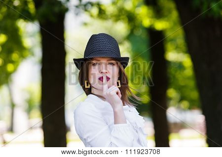Young Beautiful Woman In Hat Shows Hush Sign