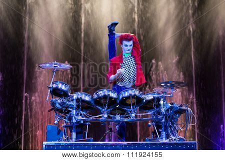 RUSSIA, MOSCOW - 18 DEC, 2014: Performer is playing on the drum kit on stage at Aquamarine circus.