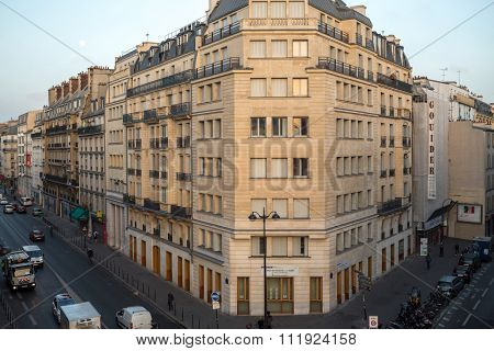 FRANCE, PARIS - SEP 10, 2014: Cityscape of street with a parking and traffic.