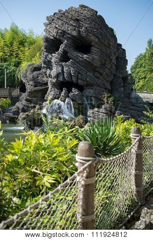 FRANCE, PARIS - 10 SEP, 2014: Big skull waterfall in Pirates beach on Disneyland.