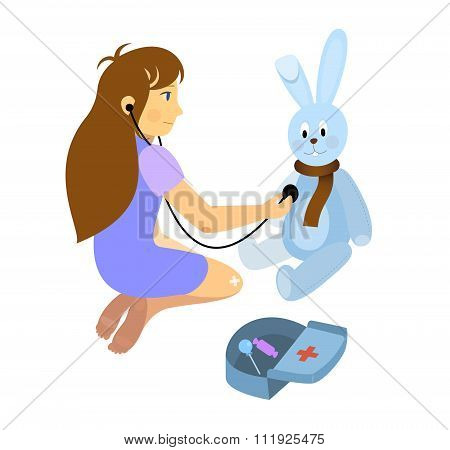 little girl playing a doctor with plush rabbit toy