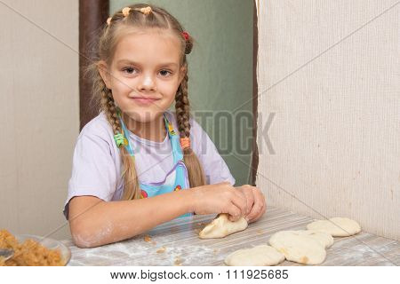 Cheerful Girl Sculpts Cakes With Cabbage