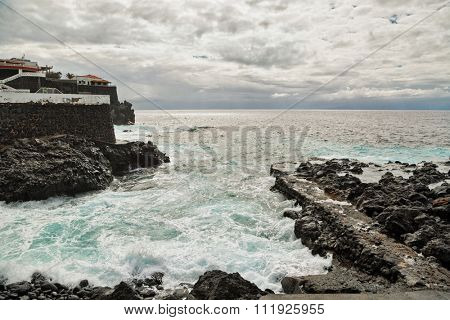 Rocks beach beach in cloudy gloomy weather. Tenerife island. Spain