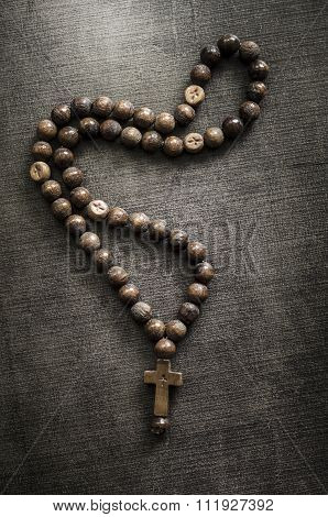 The Rosary On Old Wooden Table