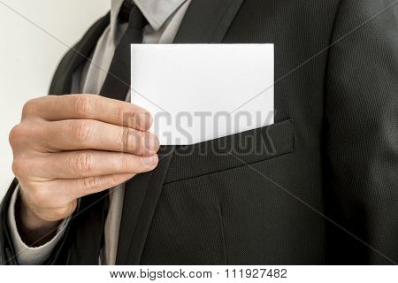 Closeup Of Businessman Removing A Blank Business Card From The Pocket Of His Suit Jacket