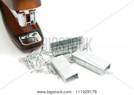 Stapler And Staples On White