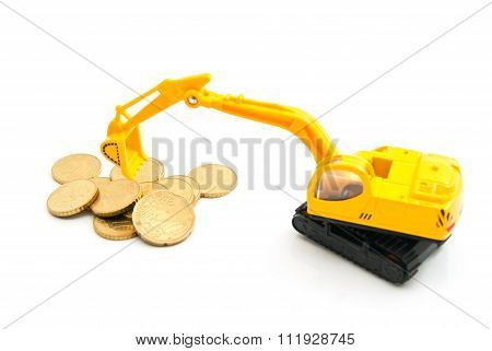 Euro Coins And Yellow Backhoe