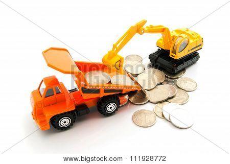 Coins, Orange Truck And Backhoe