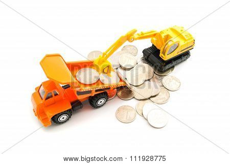Coins, Truck And Yellow Backhoe