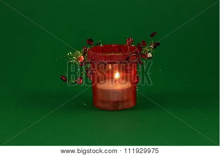 candle in red decorative candlestick