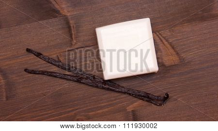 Soap vanilla on wood seen from above